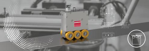 Mit Schweißnaht-Erkennungssystemen lassen sich die Schweißnähte in Blechbändern oder bei Nähten von Rohren erkennen. Der Sensor erkennt Gefüge-Veränderungen. So kann man dafür sorgen, dass die Nähte von Bändern nicht verarbeitet werden und die Nähte von Rohren beim Verformen so eingesetzt werden, dass möglichst geringe Kräfte darauf einwirken. Im Bild: SND40 flach, speziell für Blechbänder.
